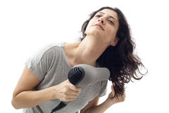 Young woman holding blow dryer Royalty Free Stock Photography