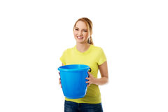 Young woman holding blue bucket. Stock Photography