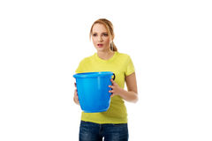 Young woman holding blue bucket. Stock Photos