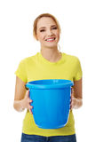 Young woman holding blue bucket. Stock Images