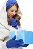 Young woman holding a blue gift Stock Photos