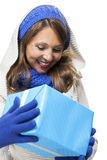 Young woman holding a blue gift Royalty Free Stock Photography