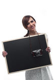 Young Woman Holding Board with Camera around Neck Royalty Free Stock Photography