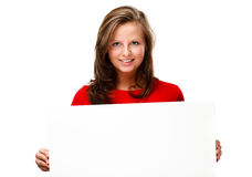 Young attractive woman behind empty board on white background Royalty Free Stock Image