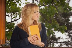 Young woman holding a book Stock Photography
