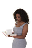 A young woman holding a book Royalty Free Stock Image