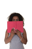 A young woman holding a book Royalty Free Stock Images