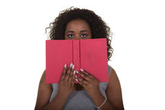 A young woman holding a book Stock Photography