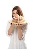 Young woman holding book with open pages Royalty Free Stock Photo