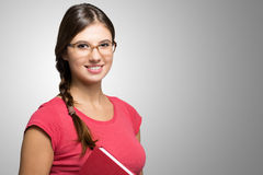 Young woman holding a book Stock Images
