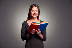 Young woman holding the books Stock Photo