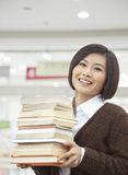 Young Woman Holding Books Stock Photo
