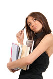 Young woman holding books and pen Stock Photography