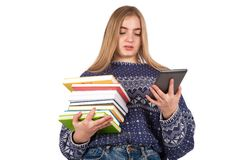 Young woman holding books and reading an ebook reader. Isolated on white background Stock Image