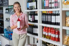 Young Woman Holding Bottle Of Alcohol Stock Photography