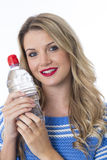 Young Woman Holding a Bottle of Mineral Water Stock Photos