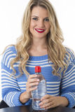 Young Woman Holding Bottle of Mineral Water. Attractive Young Woman Holding Bottle of Mineral Water Royalty Free Stock Photo