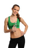 Young Woman holding a bottle of water. Isolated on a white background Royalty Free Stock Images