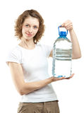 Young woman holding bottle of water. Attractive smiling young woman holding bottle of clear drinking water on white background Stock Photo