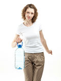 Young woman holding bottle of water. Attractive smiling young woman holding bottle of clear drinking water on white background Royalty Free Stock Photos