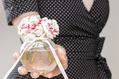 Young woman holding bouquet of carnation flowers Royalty Free Stock Photography