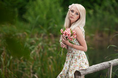Young woman holding bouquet of flowers Stock Photo