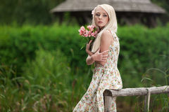 Young woman holding bouquet of flowers Royalty Free Stock Photos