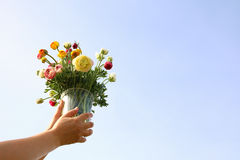 Young woman holding bouquet of spring flowers Stock Photo