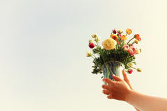 Young woman holding bouquet of spring flowers Royalty Free Stock Photos