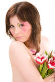 Young woman holding bouquet of tulips Stock Photography