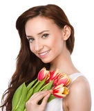 Young woman is holding bouquet of tulips Royalty Free Stock Photos