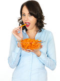 Young Woman Holding a Bowl of Carrots Stock Images