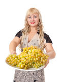 Young woman holding bowl of grapes Stock Photo