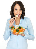 Young Woman Holding a Bowl of Mixed Vegetables Stock Image