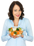 Young Woman Holding a Bowl of Mixed Vegetables Stock Photos