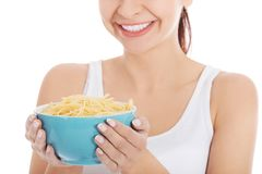 Young woman holding a bowl of noodles Royalty Free Stock Images