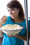 Young woman holding bowl of popcorn, smiling, portrait, close-up Royalty Free Stock Photography