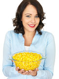 Young Woman Holding a Bowl of Sweetcorn Stock Image