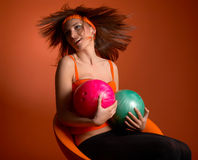 Young woman holding bowling balls Stock Images