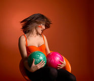 Young woman holding bowling balls Stock Photo