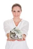 Young Woman Holding A Box Of Currency. Over White Background Royalty Free Stock Photography
