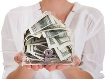 Young Woman Holding A Box Of Currency Royalty Free Stock Photos