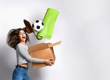 Young woman holding box with things. royalty free stock photography