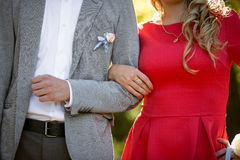 Young woman holding boyfriends arm Stock Photo