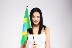 Young woman holding brazil flag Royalty Free Stock Image