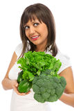 Young woman holding broccoli Royalty Free Stock Images