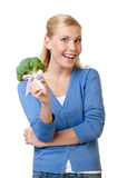Young woman holding broccoli in hand Stock Photo