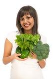 Young woman holding broccoli, salad and avocado Stock Photos