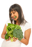 Young woman holding broccoli, salad and avocado Royalty Free Stock Photography