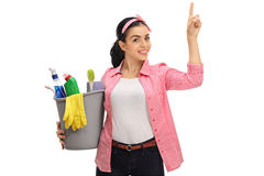 Young woman holding a bucket filled with cleaning products and p Royalty Free Stock Photos